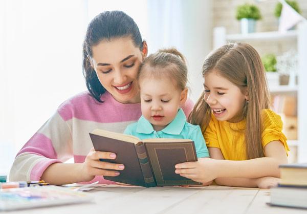 Children and Mother reading book. Happy. International Children's Book day